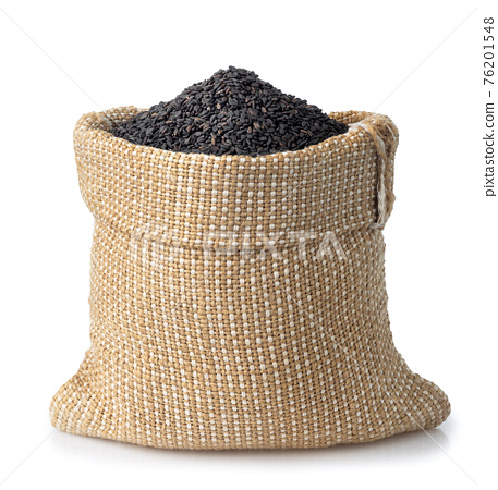 black sesame seeds in burlap sack isolated 76201548