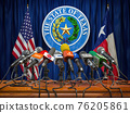 Press conference of governor of the state of Texas concept. Microphones TV and radio channels with symbol and flag of Texas state. 76205861