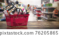 Cosmetics in shopping basket on shelf in shop. Beauty and make up products sale and purchasing online concept. 76205865