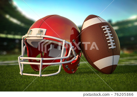 American football ball and helmet on the grass of football arena or stadium. 76205866
