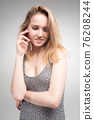 Pretty young surprised woman 76208244