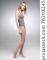 Attractive sad girl in gymnastics suit 76208245