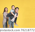 Happy Asian young family  child standing  smiling 76218772