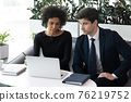 Diverse businesspeople brainstorm working together in office 76219752