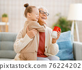 nice girl and her grandmother 76224202