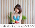 Portrait of young pretty sexy Asian woman wearing blue bikini in her room. 76224227