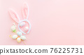 Bunny ears and eggs on pink backround on Easter day. Celebrating Easter at spring. 76225731