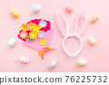 Eggs and craft flowers on pink backround on Easter day. Celebrating Easter at spring. 76225732