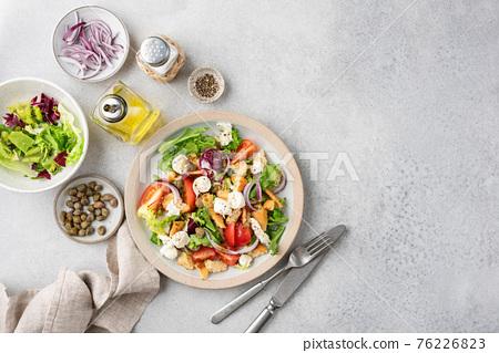 Panzanella salad with mozzarella cheese 76226823