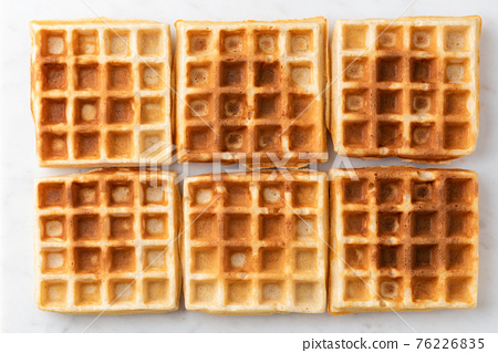 Belgian waffles texture isolated on white background 76226835
