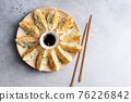 Gyoza fried chinese dumplings on bamboo plate 76226842