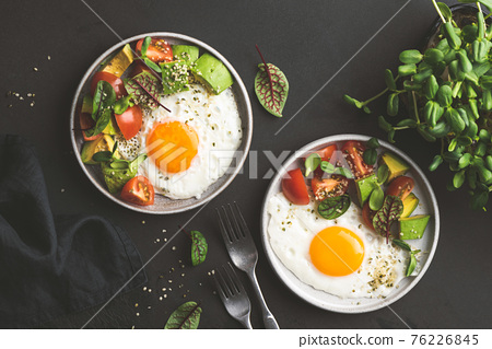 Sunny side up egg breakfast with avocado salad 76226845