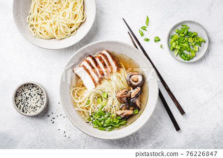 Chicken ramen noodle soup bowl with mushrooms 76226847