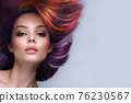 Beautiful woman with multi-colored hair and creative make up and hairstyle. Beauty face. 76230567