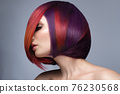 Beautiful woman with multi-colored hair and creative make up and hairstyle. Beauty face. 76230568
