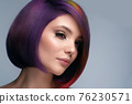 Beautiful woman with multi-colored hair and creative make up and hairstyle. Beauty face. 76230571