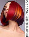 Beautiful woman with multi-colored hair and creative make up and hairstyle. Beauty face. 76230572