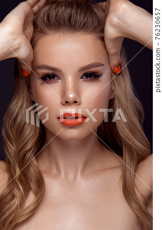 Beautiful young woman with bright makeup and neon pink nails. Beauty face. 76230657