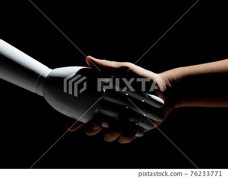 robot hand shake with human 76233771