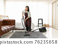 Senior woman using vacuum cleaner at home. 76235658