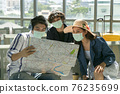 Happy tourists sightseeing with map in the airport. 76235699