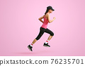 Sporty woman runner in silhouette on pink background. Side view. Sport and healthy lifestyle 76235701