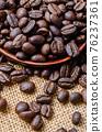 Coffee beans on sack. 76237361