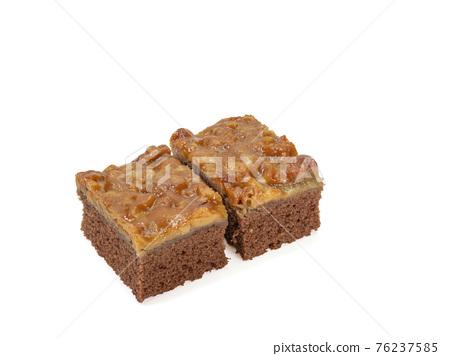 Toffee cake, a close up of homemade caramel nut chocolate cake bakery isolated on white background. 76237585