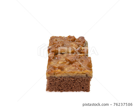 Toffee cake, a close up of homemade caramel nut chocolate cake bakery isolated on white background. 76237586