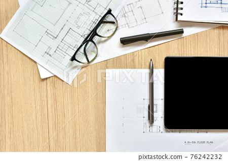 a top view of architect working desk with equipments for drawings pens sketched idea on wood table, the concept of modern technology for architectural working with tablet 76242232