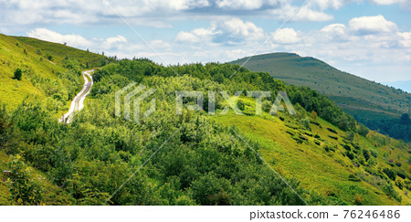 road through mountain hills. beautiful summer landscape in the morning. clouds on the sky 76246486