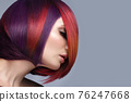 Beautiful woman with multi-colored hair and creative make up and hairstyle. Beauty face. 76247668