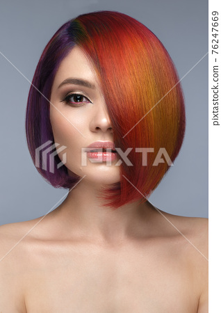 Beautiful woman with multi-colored hair and creative make up and hairstyle. Beauty face. 76247669