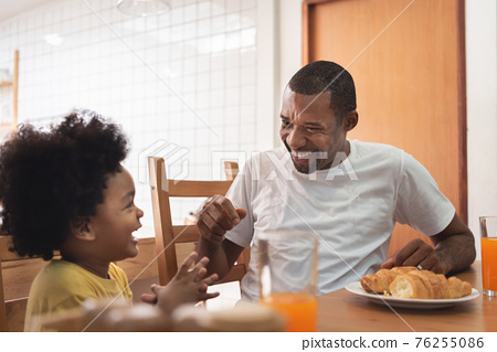 Happy smiling Loving Black African American Father and cute child boy playing together 76255086