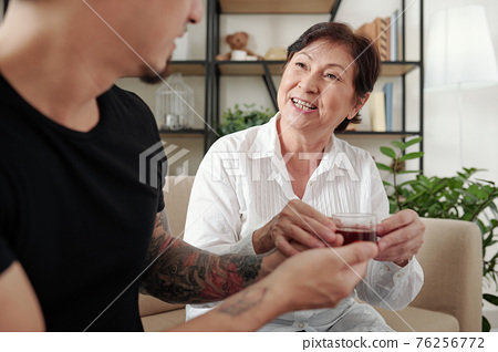 Son brining coffee to mother 76256772