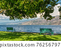 Recreation area along a waterfront pathway on Okanagan lake 76256797