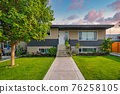 Average family house with concrete pathway over front yard 76258105
