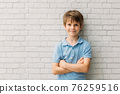 Cute little boy with crossed arms 76259516