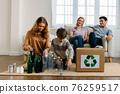 Children arranging bottles for recycle 76259517