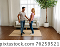 Young couple standing and laughing together 76259521
