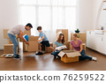 Family packing boxes for shifting home 76259522