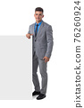 Business man in suit with banner 76260924