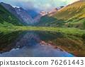 Illuminated mountains reflection in lake 76261443