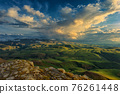 Sunset on hills in Caucasus mountains 76261448