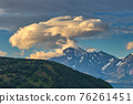 Lenticular cloud formation over volcano 76261451