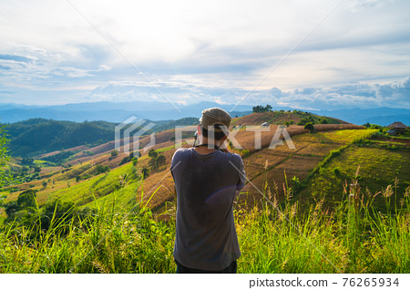 Portrait of senior man photographs rice field terrace in Ban Pa Bong Piang village Chiangmai 76265934
