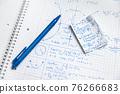 Math handwriting in notebook closeup 76266683