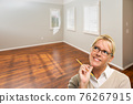 Woman With Pencil In Empty Room of New House 76267915