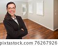 Woman In Empty Room of New House 76267926
