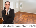 Woman In Empty Room of New House 76267928